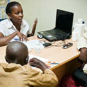 One of my study coordinators evaluates a family in the clinic.