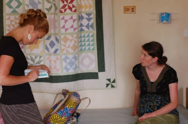 Consulting with Juli about patients at the Living Room and Kimbilio Hospice.